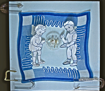 Fixing Things Is Sometimes Easy  Eisenhower era handkerchief and coloring book illustrations,  baby bird skeletons, newt, laboratory glass, paints on canvas in Lucite box  20 x 20 x 5 in.