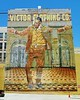 "Athony Quinn in his role of Zorba the Greek. But here, he is ""The Pope of Broadway"" at the rear of the lot at 258 W. 3rd Street. The Victor Clothing Company closed in 2001 after about 60 years in business. This painting was completed by artist Eloy Torrez in 1985."
