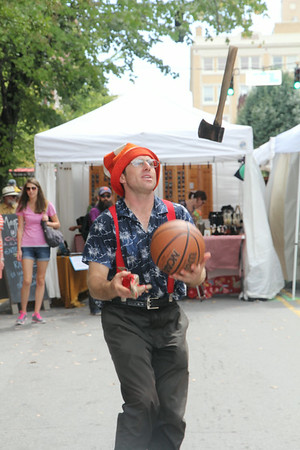 juggling with a hatchet, a shoe and a basketball