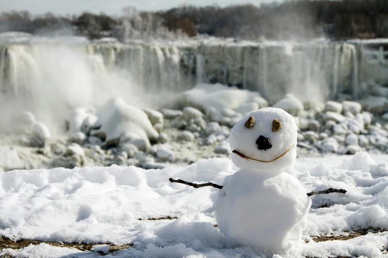 Snowman at Niagara Falls in Winter - American Falls