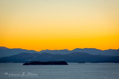Juniper Island on Lake Champlain with the Adirondack Mountains of New York on the far shores.  Burlington, Vermont
