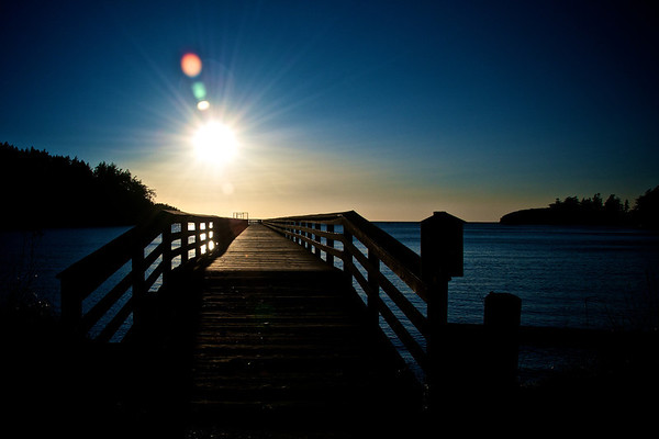 The sun beginning to set over Bowman Bay in Deception Pass State Park. Photo by Jared Rogers