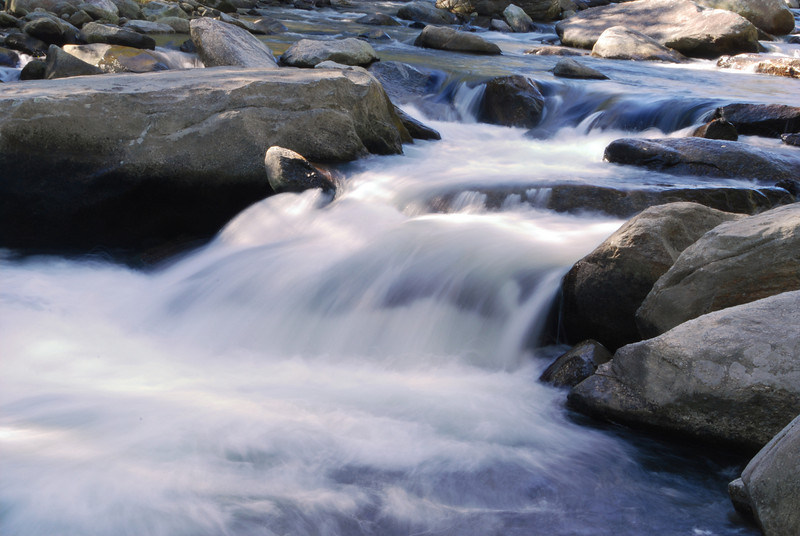 A photograph of a waterfall at Rocky River in Bat Cave NC near Chimney Rock