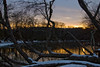 A photograph landscape of the French Broad River at Carrier Park in West Asheville NC at sunset with snow.