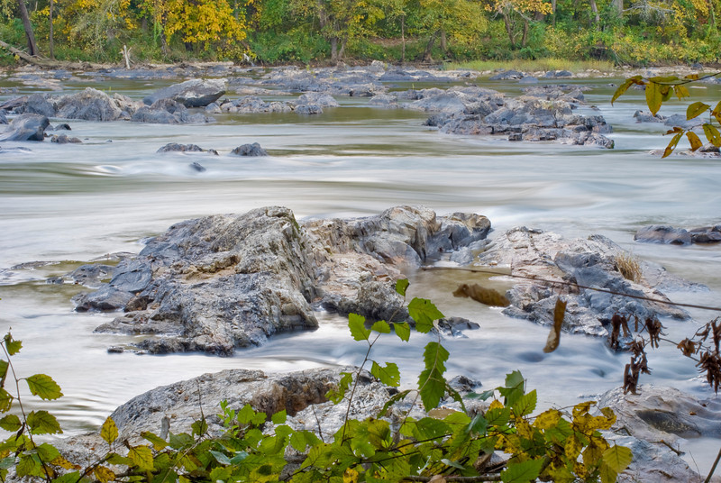 landscape of the French Broad River Ledge Whitewater Park in autumn