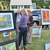 "A pop-up art show was held on the lawn of Eleanor ""Ellie"" DeLibero, on Doyle Street in Leominster on Wednesday afternoon. Along with her husband John, she helped to start the Leominster Art Association. SENTINEL & ENTERPRISE / Ashley Green"