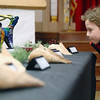 Gil Cohen, 5, looks over a table of art work at the second annual art show for city students from elementary through high school at Leominster City Hall Tata Auditorium on Wednesday night. SENTINEL & ENTERPRISE/JOHN LOVE