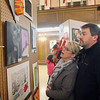 Donna Boucher and Leo Boucher look at some of the at work at the second annual art show for city students from elementary through high school at Leominster City Hall Tata Auditorium on Wednesday night. Their daughter a senior at LHS had work in the show. SENTINEL & ENTERPRISE/JOHN LOVE