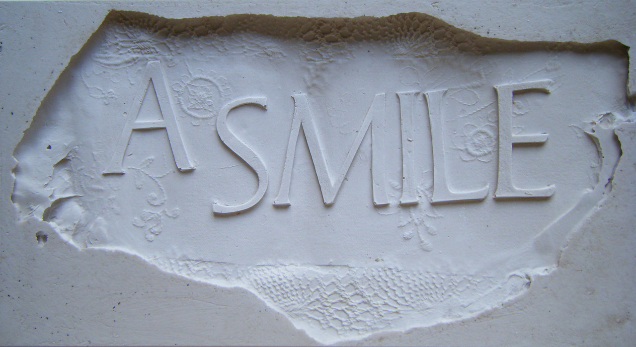 Bamber Hawes ~ A smile, raised plaster lettering