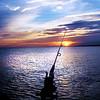Fishing early on Lake Michigan at Michigan City, IN.