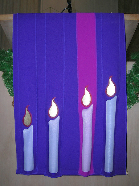 Advent pulpit parament in the Sanctuary. A candle is added each week throughout the four Sundays of Advent.
