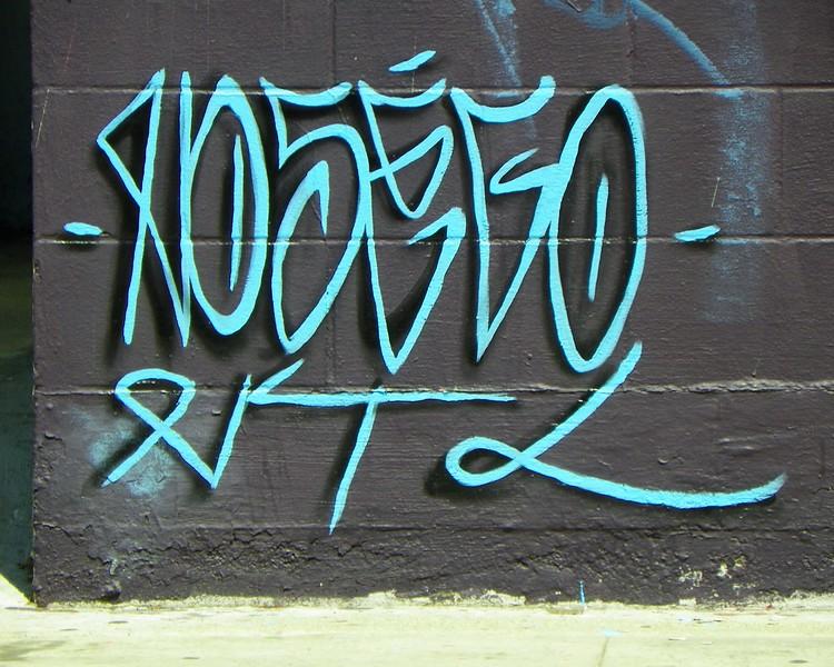 Artist's signature at 1412 MLK Jr. Blvd.