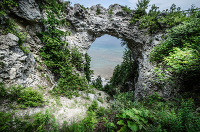Arch Rock is a geologic formation on Mackinac Island in Michigan. It is a natural limestone arch formed during the Nipissing post-glacial period, a period of high Lake Huron levels following the end of the Wisconsin glaciation. To this day Arch Rock stands on the Lake Huron shoreline 146 feet (45 m) above the water.  info from wiki