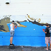 Marion Stoddard, an environmentalist who was instrumental in cleaning up the Nashua River, visited the Fitchburg mural honoring her on Tuesday to see it for the first time. She got to see artists Jon Allen, 38, and Sophy Tuttle, 27, as they worked on it during her visit. SENTINEL & ENTERPRISE/JOHN LOVE