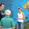 Marion Stoddard, an environmentalist who was instrumental in cleaning up the Nashua River, visited the Fitchburg mural honoring her on Tuesday to see it for the first time. She got to chat with artists Jon Allen, 38, and Sophy Tuttle, 27, as they stopped working for a moment to chat with her during her visit. SENTINEL & ENTERPRISE/JOHN LOVE