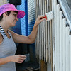 Artist Sophy Tuttle begins the base coat of a mural she is working on with fellow artist Jon Allen. The mural will be honoring longtime environmentalist Marion Stoddart, a woman who led the campaign to clean up the Nashua River. SENTINEL & ENTERPRISE / Ashley Green