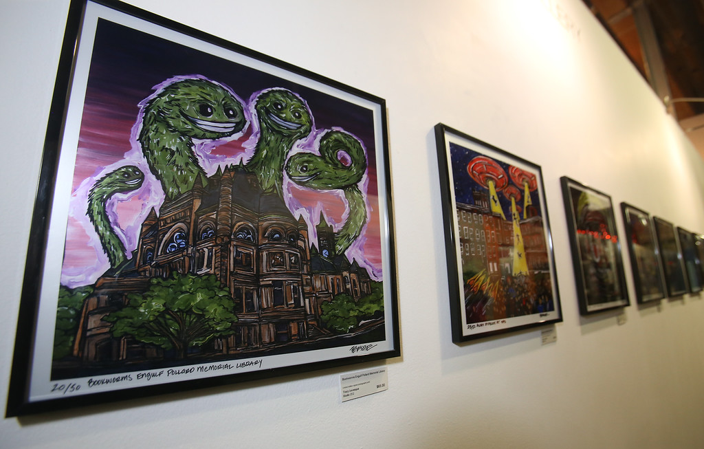 ". ""Bookworms Engulf Pollard Memorial Library, one of artist Tracy Levesque\'s series of limited edition prints of monsters attacking Lowell landmarks. (SUN/Julia Malakie)"