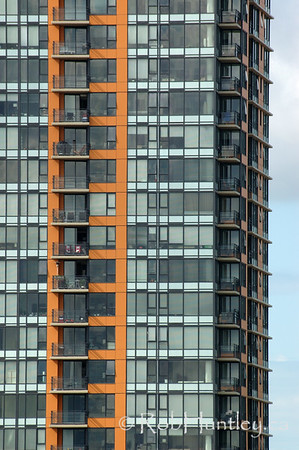 Canada chairs. Patterned windows and balconies on a condominium building in Vancouver, British Columbia.