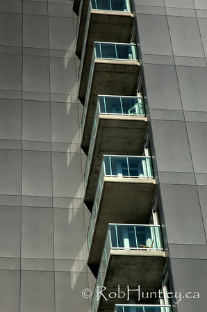 Condo Abstract. Abstract of condominium balconies and textured wall siding. Ottawa, Ontario, Canada. HDR  Currents Condominium at Wellington Street and Holland Avenue, also home of the Great Canadian Theatre Company - GCTC.