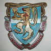 Coat of arms designed by Adlaide Waltz and carved by Sister Eileen.