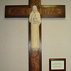 Hand-carved cross from Father Brunner's wooden trunk; the corpus is made of terra cotta.