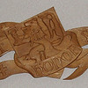 Hand-carved scroll. LAUS ET HONOR SANGUINI JESU (Praise and Honor to the Blood of Jesus).