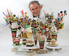 Ft. Lauderdale artist John Pack and a few of his sculptures. Pack uses, among other things, rocks, shells and sea glass. Pack's edible-appearing creations can be acquired through Rossetti Fine Art in Wilton Manors, Florida.
