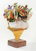 This sculpture was created by Ft. Lauderdale artist John Pack. He uses, among other things, rocks, shells and sea glass. Pack's edible-appearing creations can be acquired through Rossetti Fine Art in Wilton Manors, Florida.