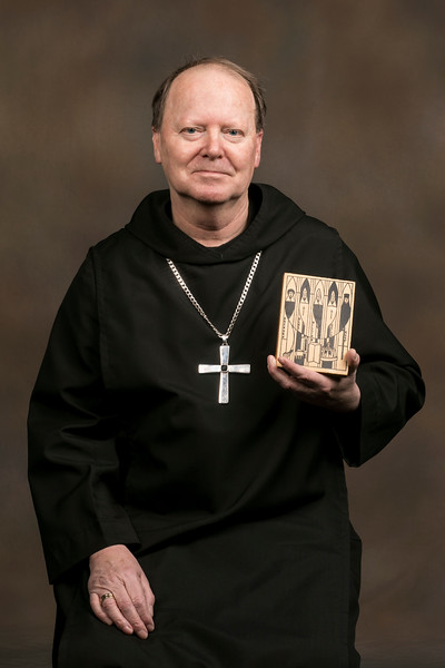 Archabbot Kurt Stasiak, OSB, has the image used for the invitations for his solemn vows displayed in his faculty office at Saint Meinrad. The image was designed by a classmate who was also making solemn vows and includes the five monks being solemnly professed. Abbot Kurt's patron saint is Constantine.