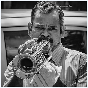 Melancholy - a man playing trumpet in a western-styled street band
