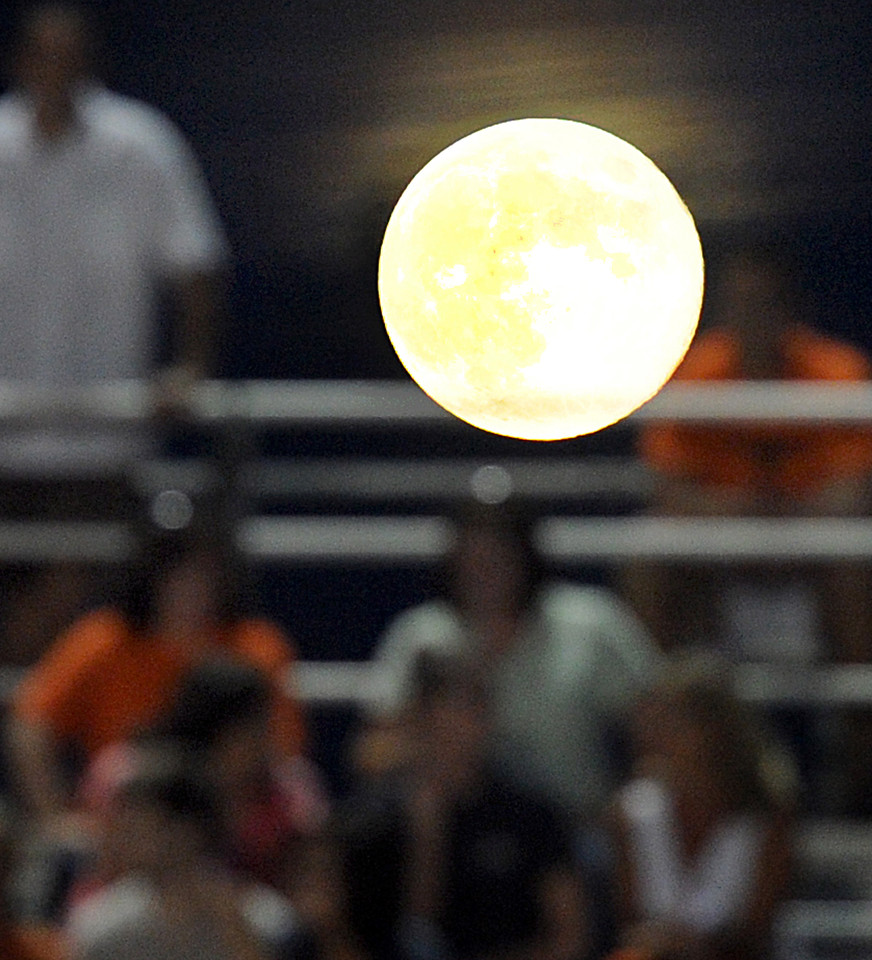 "Another look at the Full Moon at the game.<br /> A Full Moon, and this one know as a Blue Moon, shines brightly over Mauldin's Freeman Field Friday night during the Mauldin-Woodmont Football Game.<br /> According to NASA, this was the second time in August that a full moon was seen - the first was on August 1 to 2. This phenomenon, which is referred to as the 'blue moon', happens every two and a half years on average. More photos here <a href=""http://www.gwinndavisphotos.com/"">http://www.gwinndavisphotos.com/</a>, thanks for the clicks, Gwin<br /> Just posted more photos. Go to gwinndavisphotos.com and click on the gallery for a slide show of images. Thanks, Gwinn_<br /> The Mauldin Mavericks played host to the Woodmont Wildcats in a Class-AAAA football game.<br /> GWINN DAVIS PHOTOS<br /> gwinndavisphotos.com (website)<br /> (864) 915-0411 (cell)<br /> gwinndavis@gmail.com  (e-mail) <br /> Gwinn Davis (FaceBook)"