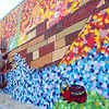 The mural by Caleb Neelon's on the side of the Arc of Opportunity building was almost done as of Friday June 27, 2014 around 4:30 p.m. Neelon was just putting the finishing touches on it. SENTINEL & ENTERPRISE/JOHN LOVE