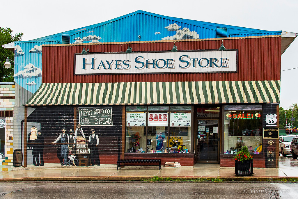 .<br /> In the early 1900s, Prosperity Corner drew citizens of the town and surrounding farming communities to meet, do business & pass the time of day at H.H. Tieman's General Merchandise Store.  Today, Hayes Shoe Store stands on the original site of Prosperity Corner with murals that reflect scene from the earlier period.