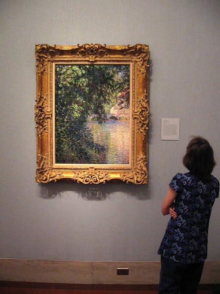 """Becky studies the """"Mill at Limetz"""" by Claude Monet ."""
