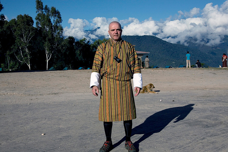 this is me in the national bhutanese dress.The national dress of Bhutan is called the gho for men and kira for women. It was introduced during the 17th century by Shabdrung Ngawang Namgyel to give the Bhutanese a unique identity.  <br /> In an effort to preserve and promote its cultural heritage, all Bhutanese are required to wear the national dress in government offices, schools and on formal occasions.  <br /> <br /> The gho is a long robe hoisted to the knee and held in place with a kera, a woven cloth belt, wound tightly around the waist. This forms a large pouch above that may be used to contain particular items, traditionally a bowl and betel nut.