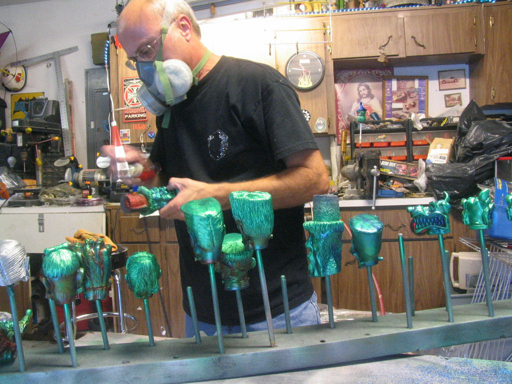 Airbrushing cast resin shift knobs.  The respirator is a necessity, this shit will kill you!