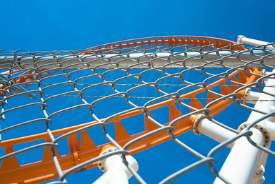 The Thunderbolt Loop through a Chain Link Fence