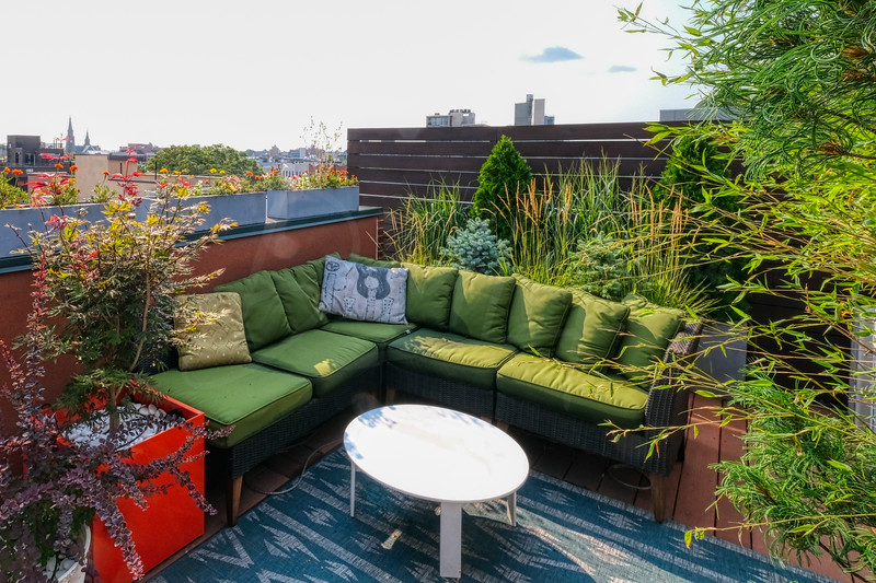 An inviting roof top green space to hang your hat after long day.