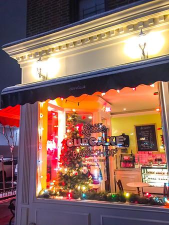 A window scene from Little Cupcake Bakeshop in Bay Ridge, Brooklyn