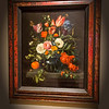 Jan Davidsz de Heem (Dutch, 1606 - 1683/4)<br /> <br /> Vase of Flowers, 1654<br /> Oil on canvas<br /> <br /> Utrecht-born Jan de Heem specialized in virtuosic flower and banquet pieces that were enthusiastically collected by aristocrats and wealthy merchants alike. This exquisite still life presents a harmonious marriage of color and line and attests to the artist's ability to describe with great precision a range of forms, textures and colors. All the elements are ordered along several axes that meet at the center of the composition, while myriad details throughout, including flowers rendered with the accuracy of a botanist, encourage prolonged examination. However, the sense of movement created by these dynamic lines guides the eye through the still life, so that it does not rest on any one particular detail for too long.<br /> <br /> The vanitas theme that was so popular in early examples of the genre waned by the second half of the 17th century, as an interest in the decorative supplanted the emphasis on moralizing iconography. Though de Heem included certain symbols associated with the theme (drooping flowers, a shaft of wheat and short-lived insects), his focus lay in the bravura painting of beautiful motifs in arrangements that signify abundance.