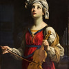 Guido Reni (Italian, 1575 - 1642)<br /> <br /> St. Cecilia, 1606<br /> Oil on cavas<br /> <br /> St. Cecilia, the patron saint of musicians, was an early Christian martyr. According to legend, she could play any musical instrument and was so exalted she could hear the singing of angels. Here, with her eyes turned toward heaven, she plays a violin; in the background is an organ.<br /> <br /> The elegant St. Cecilia exhibits the refined sensibility and pious sentimentality that made Guido Reni the most sought-after Bolognese painter of the seventeenth century. This early work was commissioned by Cardinal Emilio Sfondrato. The cardinal enthusiastically promoted the ult of St. Cecilia after the discovery of her remains in 1599. The picture was soon acquired by Cardinal Scipione Borghese, another prominent Roman patron of Reni, and was later owned by Lucien Bonaparte and Marie-Louise Josephine, Queen of Etruria.