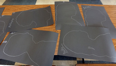 Tsongas Industrial History Center hosts Old Tyme Art, for kids to learn how to write with quill pens, and get their silhouettes drawn, as part of Kids Week during school vacation week. Some of the silhouettes done.  (SUN/Julia Malakie)