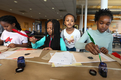 Tsongas Industrial History Center hosts Old Tyme Art, for kids to learn how to write with quill pens, and get their silhouettes drawn, as part of Kids Week during school vacation week. From left, Talia Njui, 10, her sisters Imani Njui, 9, and Bella Njui, 6, and their cousin Mikayla Mwangi, 13, all of Lowell. (SUN/Julia Malakie)