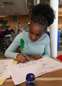 Tsongas Industrial History Center hosts Old Tyme Art, for kids to learn how to write with quill pens, and get their silhouettes drawn, as part of Kids Week during school vacation week. Mikayla Mwangi, 13, of Lowell. (SUN/Julia Malakie)