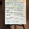 White board showing upcoming art workshops/classes.