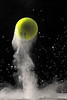 "Tennis ball bouncing off of baby powder. <br /> <br /> Our local Photo store sponsored classes, and the Nikon training rep. showed us how to photograph a number of fun things. (see: <a href=""http://www.flickr.com/photos/pva1964/"">http://www.flickr.com/photos/pva1964/</a> )"