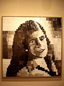 This picture consists of newspaper articles, all different hues to make up this portrait of a woman. Every square has some mention of photography, or cameras or pictures. Chicago Museum of Art.