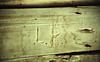 Initials of Lawrence Ringelstetter Carved in Barn Door, Sauk County, Wisconsin