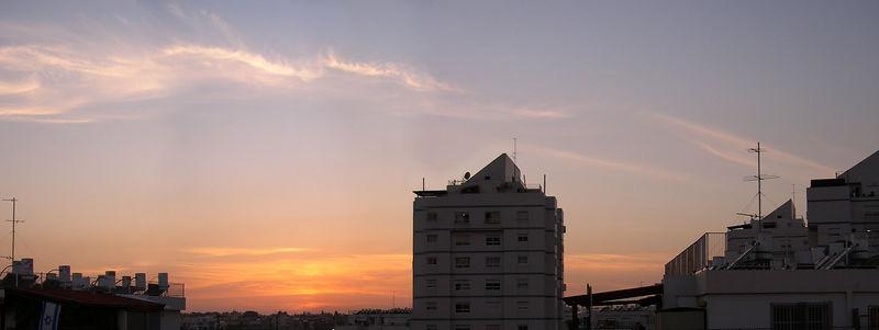 Sunset on the roofs. Ganey Aviv. Four vertical shots