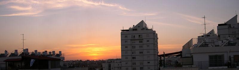Sunset on the roofs. Ganey Aviv. Four horizontal shots